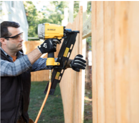 Installing a pressure-treated wood fence